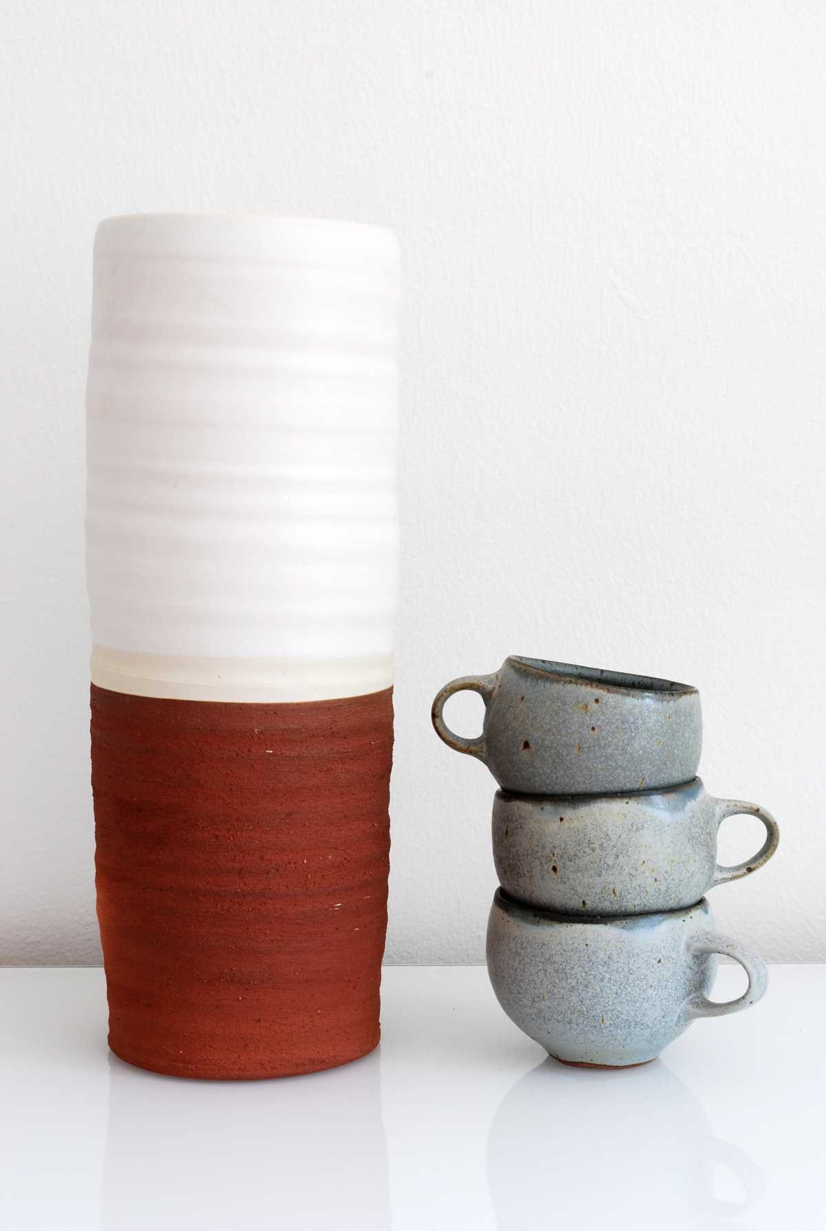 a10_mdba_mdby_manufactured_ceramics_wood_concrete_sculptures_phil_finder_red_white_cups